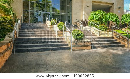 Large Hand Railing Stairway Separated With Flowerbeds