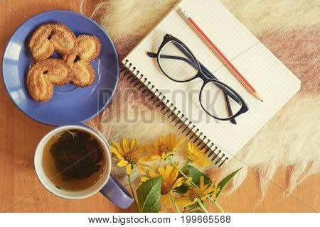 Top Shot Of Writer Breakfast With Notebook