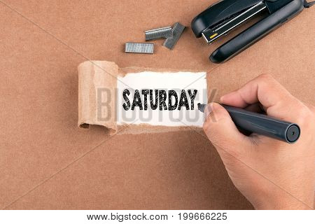 Saturday. Inscription in window of torn paper.