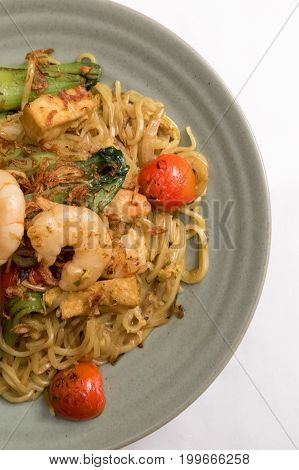 Mie Goreng, Fried Yellow Noodle With Prawn Seafood, Vegetable, Tomato, Choy, Egg, Garlic, Shallot, O