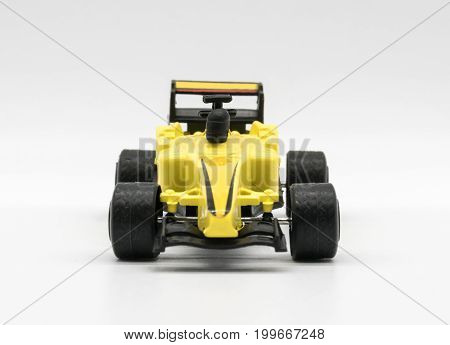 Yellow Toy As Formula Car Isolated On White