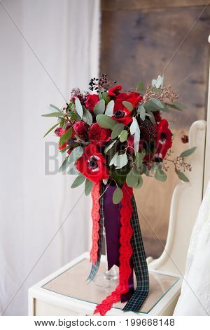 red Wedding flowers bouqete in studio background