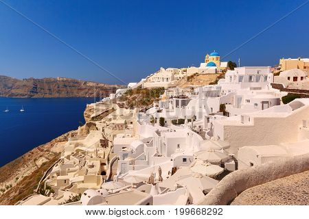 Typical Greek church and white houses in Oia or Ia on the island Santorini, Greece
