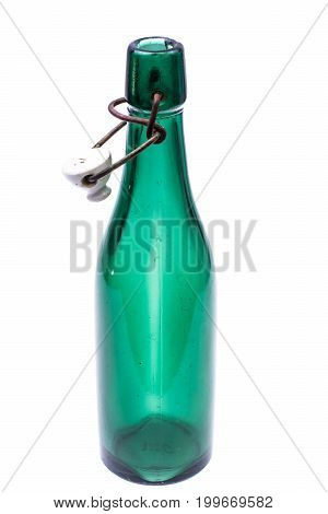 Vintage bottle with a porcelain on white background. Studio Photo