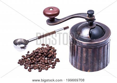 Manual mechanical metal coffee grinder. Studio Photo