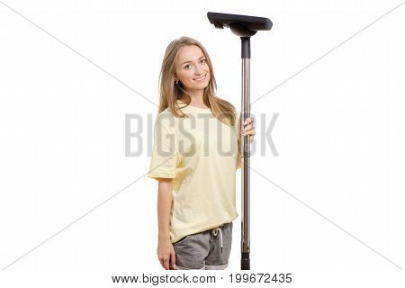 Beautiful young girl in home clothes with a vacuum cleaner on a white background isolation