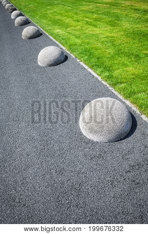 Asphalt Floor, Lawn And Hemisphere Barriers.