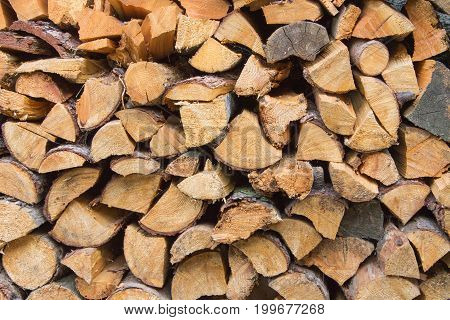 Wooden sticks stacked on each other neatly. They are used to turn on the fire.