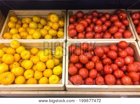 Fresh juicy Tomato on store shelves Photo