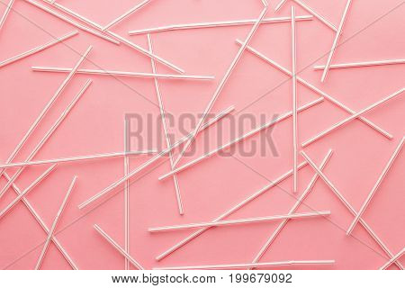 red striped bendy cocktail straws. cocktail straws on pink background. top view of bendy cocktail straws. red cocktail straws background