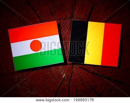 Niger Flag With Belgian Flag On A Tree Stump Isolated