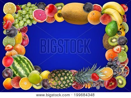 Food background - Frame of assorted juicy appetizing fruit on a blue background