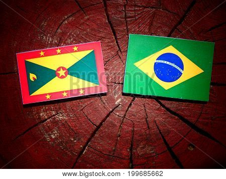 Grenada Flag With Brazilian Flag On A Tree Stump Isolated