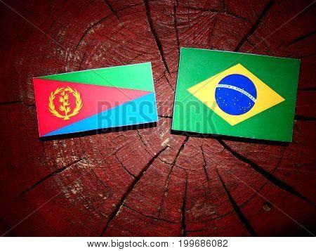 Eritrean Flag With Brazilian Flag On A Tree Stump Isolated