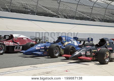 Row Of Irl Open Wheel Racing Cars On Pit Row