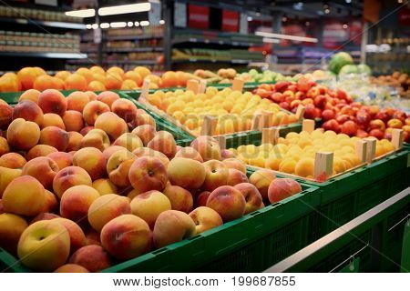 Shelf with fruits in large food supermarket, toned image