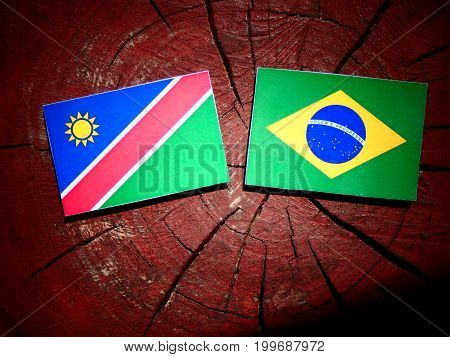 Namibian Flag With Brazilian Flag On A Tree Stump Isolated