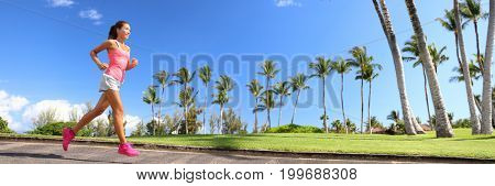 Runner woman running in park banner - active summer healthy lifestyle. Sport person jogging training cardio - horizontal crop of palm trees background for landscape copyspace.