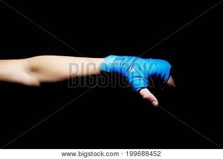 The photo of boxer fist punch. Hand on black backround.