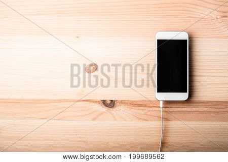 Blank Smart Phone On Wood Grain Background