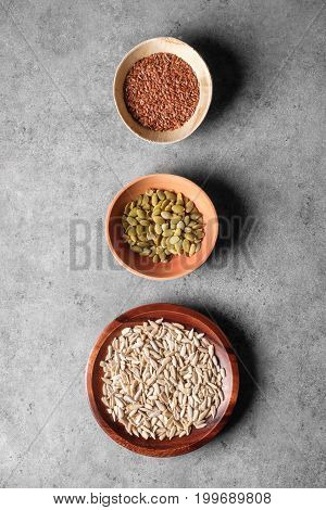 Pumpkin, Linseed And Sunflower Seeds In Bowls Viewed Above