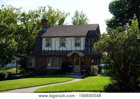 JOLIET, ILLINOIS / UNITED STATES - JULY 18, 2017: A two story, single family brick home, in Joliet's Historic Cathedral Area.