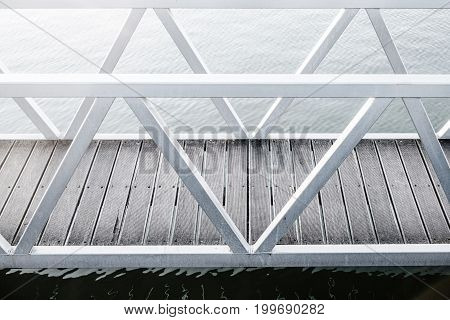 Foot bridge over water on cold day