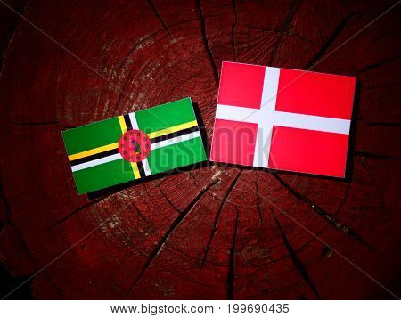 Dominica Flag With Danish Flag On A Tree Stump Isolated
