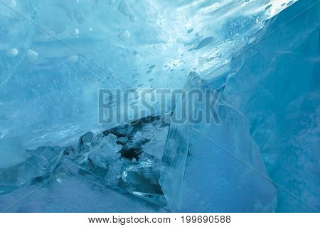 Clear blue ice blocks with luminous bubble structure, beautiful winter and christmas background, closeup