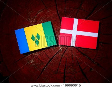 Saint Vincent And The Grenadines Flag With Danish Flag On A Tree Stump Isolated