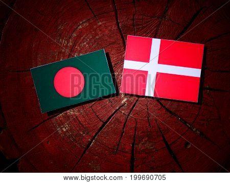 Bangladesh Flag With Danish Flag On A Tree Stump Isolated