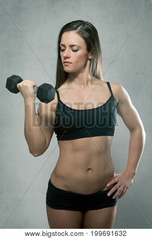 Beautiful Sporty Muscular Woman With Dumbbell