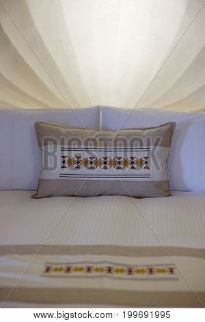 Some clean bedding linens with patterned sheets.