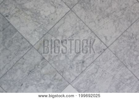 A grey marble tile pattern and background.