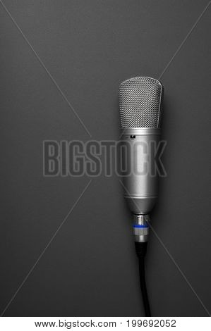 An Isolated Studio Microphone On A Grey Background