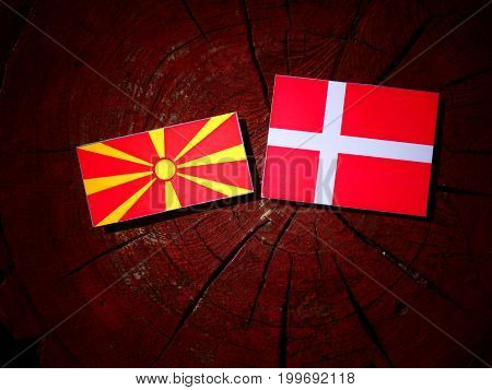 Macedonian Flag With Danish Flag On A Tree Stump Isolated