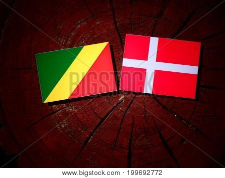 Republic Of The Congo Flag With Danish Flag On A Tree Stump Isolated