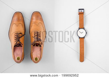 Above view of vintage mens watch and shoes