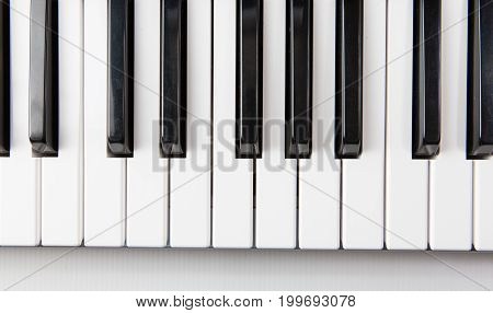 Close up of piano keys viewed from directly above
