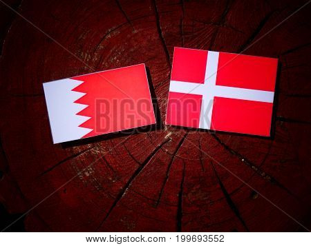 Bahraini Flag With Danish Flag On A Tree Stump Isolated
