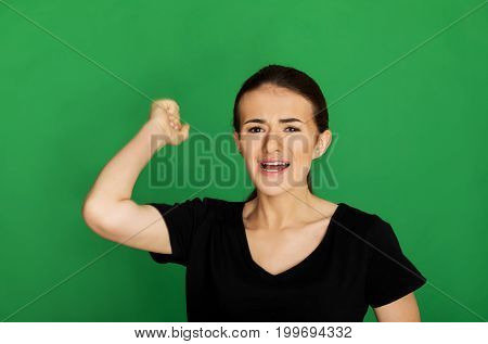 The portrait of agressive teenage girl screaming, shouting.