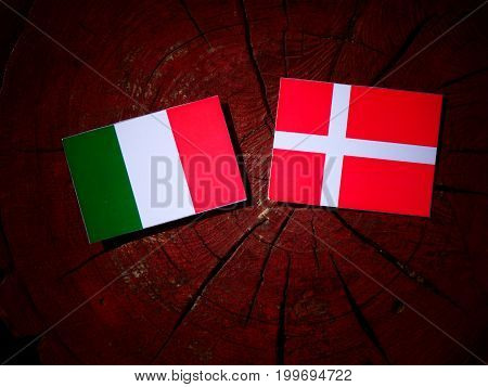 Italian Flag With Danish Flag On A Tree Stump Isolated