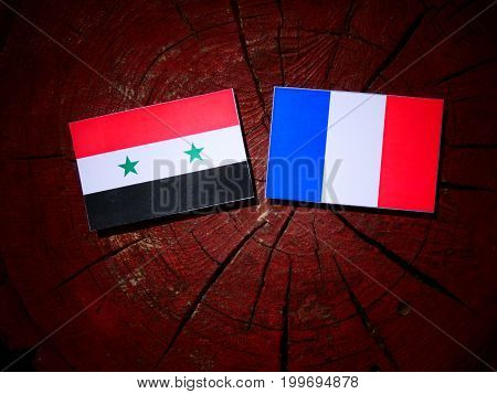 Syrian Flag With French Flag On A Tree Stump Isolated