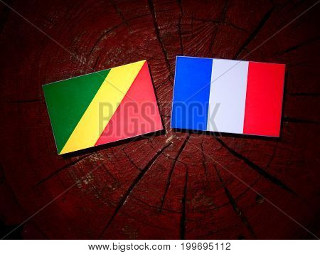 Republic Of The Congo Flag With French Flag On A Tree Stump Isolated