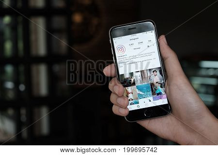 Chiang Mai, Thailand - Jun 15,2017: A Man Holds Apple Iphone With Instagram Application On The Scree
