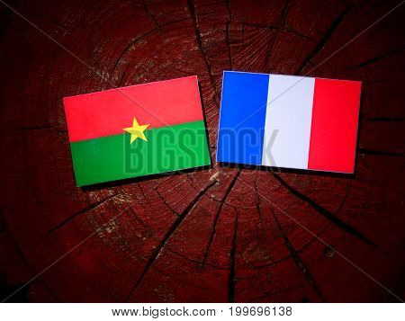 Burkina Faso Flag With French Flag On A Tree Stump Isolated