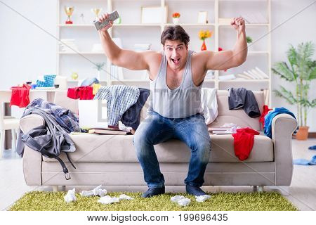 Young man working studying in messy room