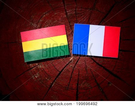 Bolivian Flag With French Flag On A Tree Stump Isolated