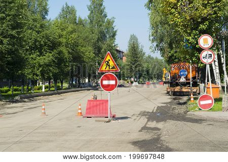 signs, stop, detour, road repair. The street is closed