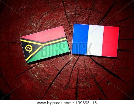 Vanuatu Flag With French Flag On A Tree Stump Isolated
